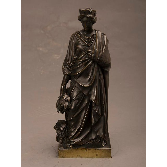 A beautiful bronze sculpture of the Roman goddess Tyche cast in France circa 1865. This figure is also known as the Roman...