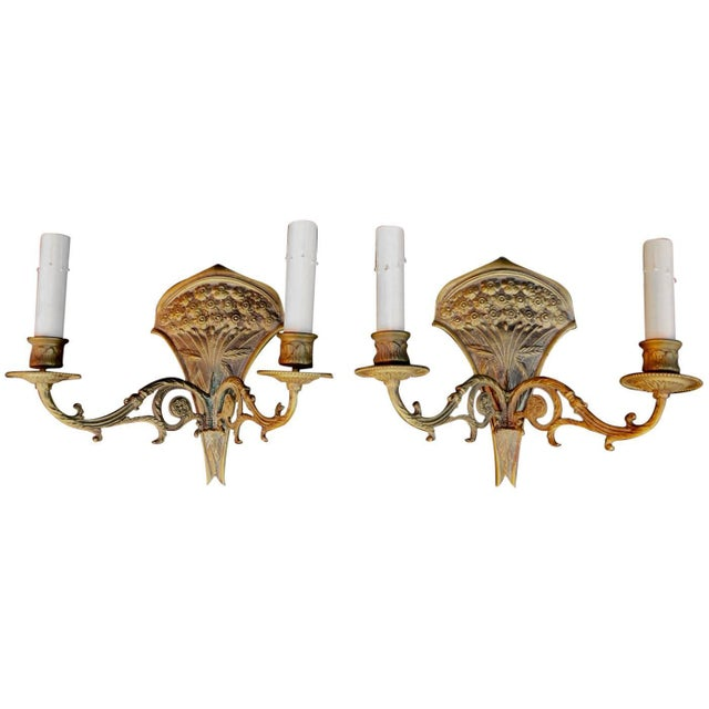 A beautiful pair of late 19th century sconces, the patina is much nicer in person.