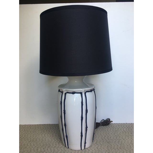 "White vintage lamp with scalloped details. Vintage navy ""icing style"" faux bamboo accents line the details of the lamp...."