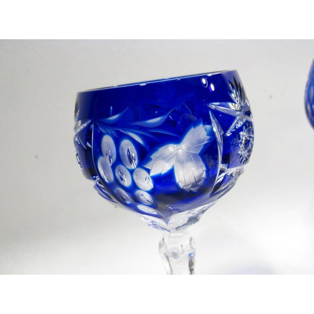 """Set of 9 - 6 7/8"""" tall hock wine goblets. In the eternal Traube pattern, fine cobalt blue cut to clear stemware, made in..."""