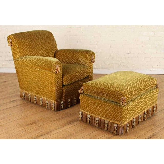 Pair of 1940s French Club Chairs with Matching Ottomans. Original fabric, has wooden legs and tassels. Chairs measures:...