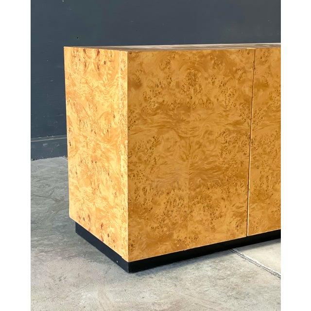 Milo Baughman burl olive wood cabinet three door sideboard, petite three-door, interior two shelf two draw compartment and...