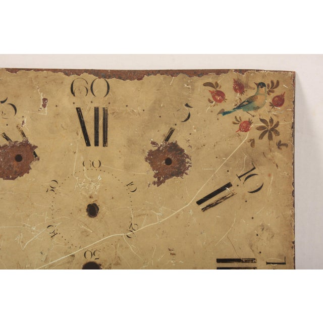 A 19th-century hand painted clock face by Carefwell of Shropshire (Salop), England featuring a bird and berry motif.