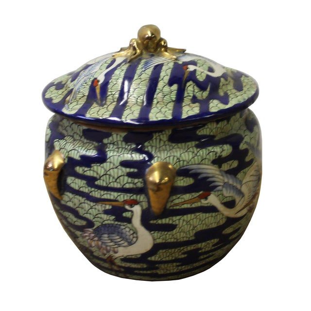 This is a Chinese decorative porcelain round box with cranes painted on the surface. It is a Republic of China period...