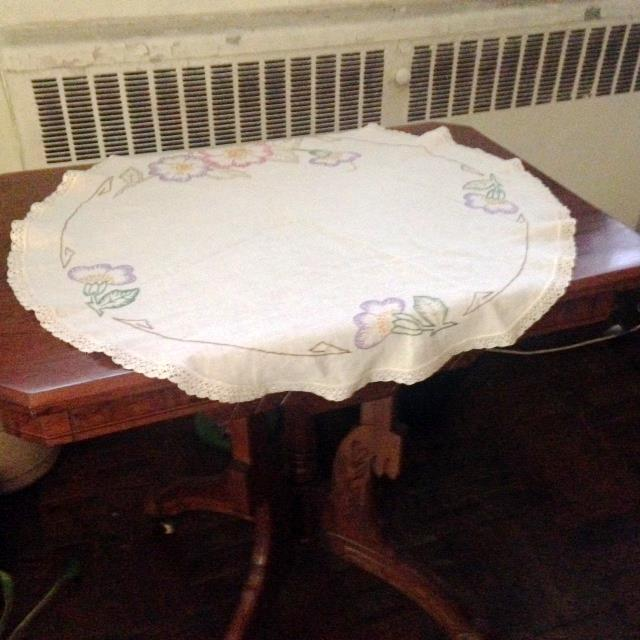 """Vintage pastel-colored doily. This embroidered linen features a lace border. Measures 27"""" in diameter. Has some age-..."""