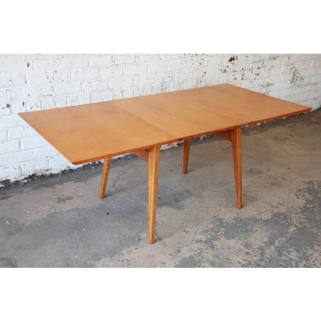 """Offering a beautiful and versatile Jens Risom dining table. This extension table comes with one leaf as it expands 72""""..."""