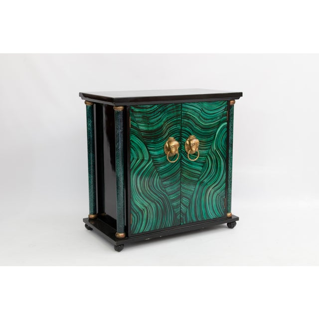 Art Deco faux malachite and black lacquered cabinet with gilded sekhmet pulls. Hand-painted in a style reminiscent of...