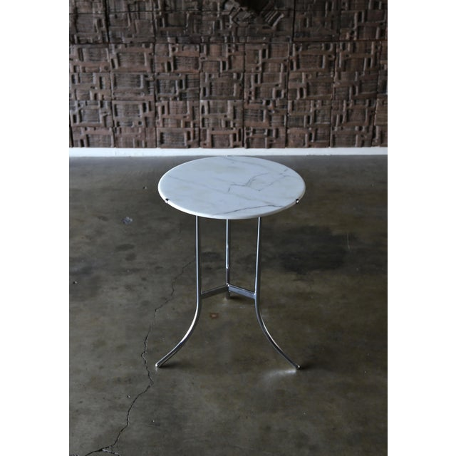 "Cedric Hartman occasional / side table circa 1975. This piece is stamped ""Cedric Hartman"" to the base. The marble top..."