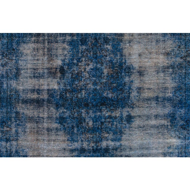 Vintage hand-knotted Overdyed distressed rug with a medallion floral motif. This piece has great detailing and a beautiful...