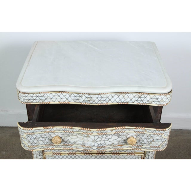 Fabulous pair of Middle Eastern Syrian mother-of-pearl inlay nightstands. Handcrafted white small wedding dresser with...