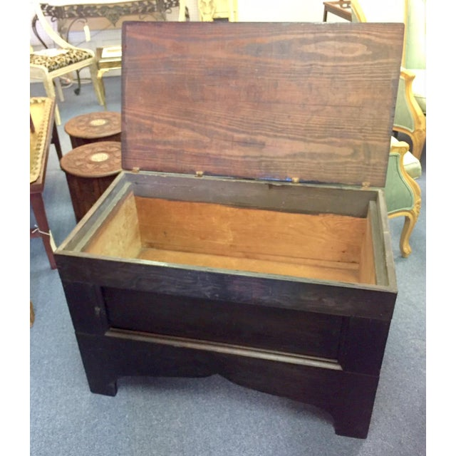 Large primitive style trunk made of solid oak in a dark wood stain. Trunk has a rustic look. So many uses around the home!...