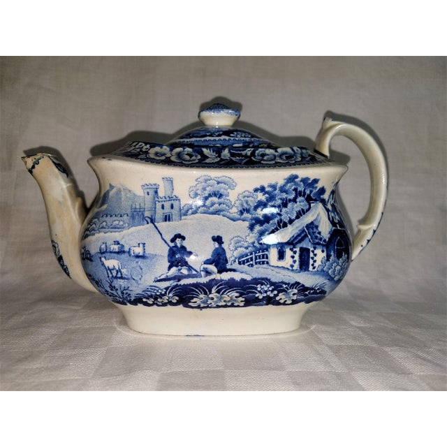This antique Staffordshire blue and white tea pot is marked Wm Davenport, Longport England on bottom of the pot. See...