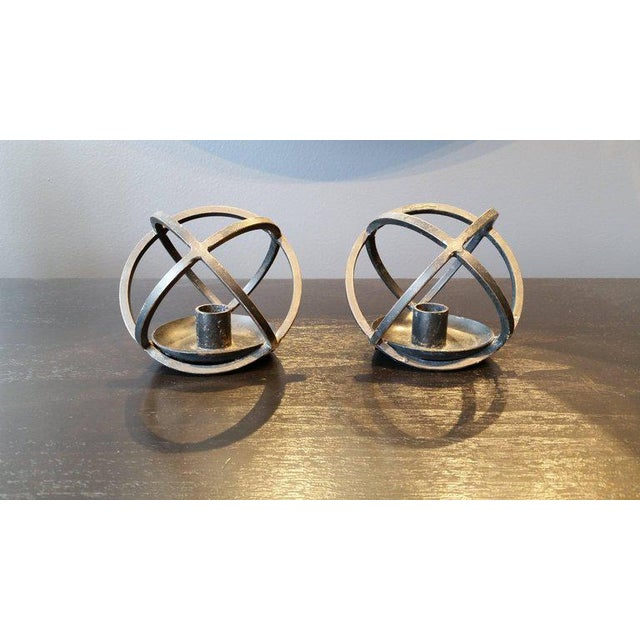 Sculptural hand-forged wrought iron Scandinavian Mid-Century Modern candlestick holders. Lovely additions to a dining...