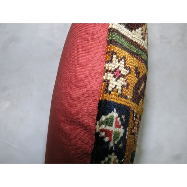 Pillow made from a 19th centuy caucasian rug with red cotton back. Zipper closure and foam insert provided. 14'' x 17''
