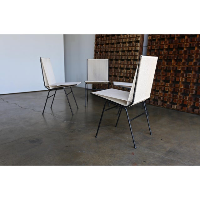 "Set of four Allan Gould ""string"" chairs manufactured by Allan Gould Designs, New York, circa 1952."