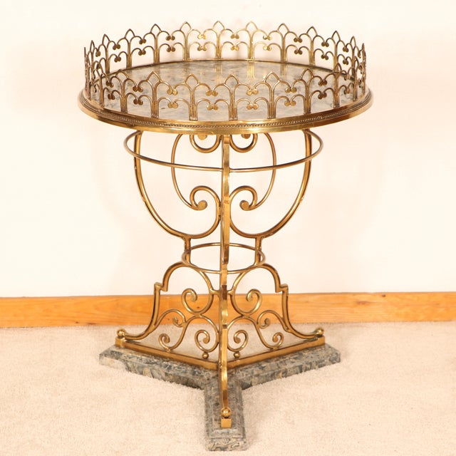 Elegant center table! It is made out of marble and features brass detailing. From the 1980s. In good condition; chipped...