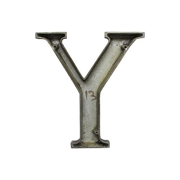 Mid-century aluminum sign letter Y with original black finish. Letter has wear from outside use, discolorations, chips in...