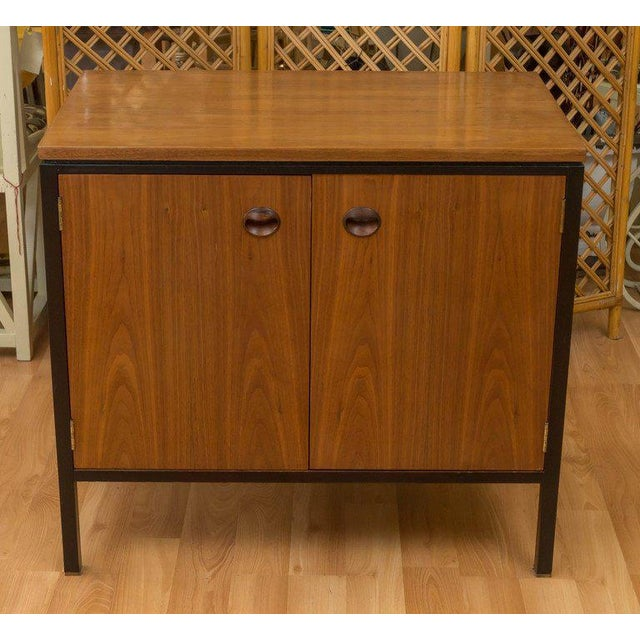 Edward Wormley design for Dunbar small rosewood and walnut cabinet. Behind the two doors you'll find one shelf that's...