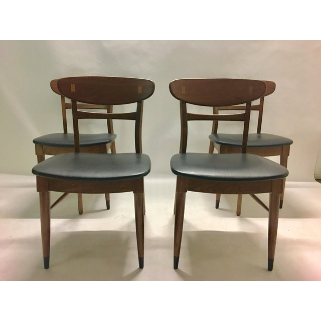 Mid century modern Danish dining chairs with butterfly inlays in chair back. They are newly refinished. Has the original...
