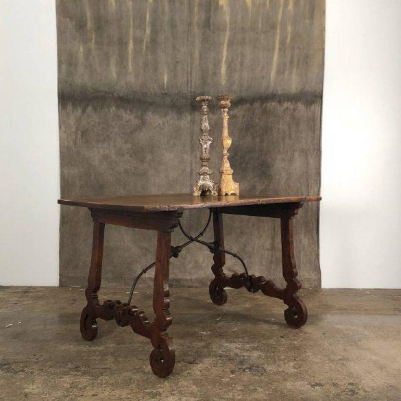 Beautiful walnut table with forged iron stretcher. Item arrives to US in December 2018.