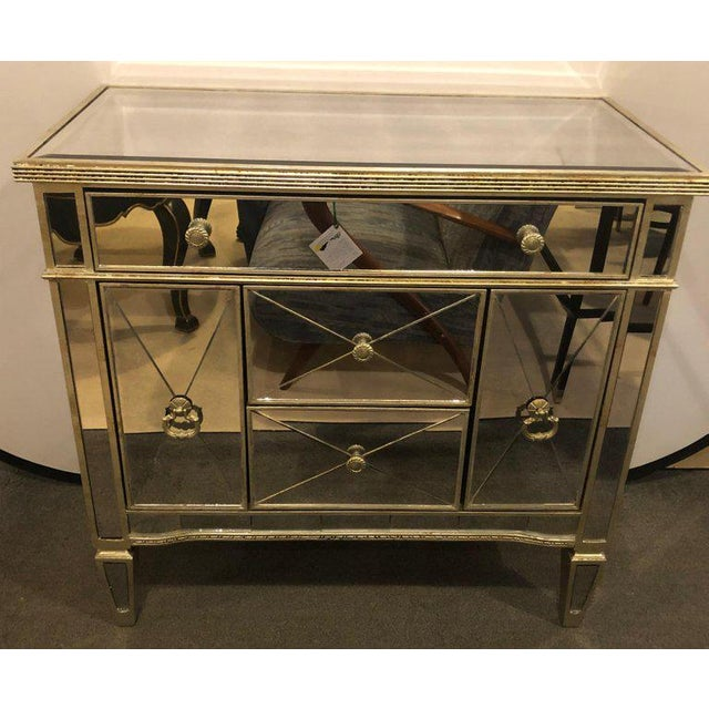 Mirrored Hollywood Regency style large nightstand or commode. Having two center drawers flanked by large side rectangular...