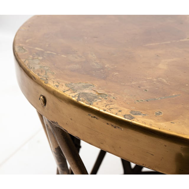 Brass drum Hollywood Regency style table with original patina, circa 1960s. The piece measures 24.00 Inches diameter....
