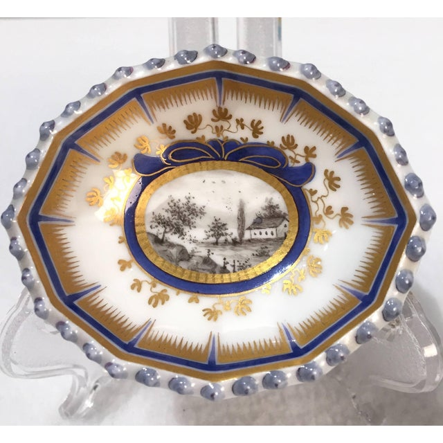 This pair of Master Salt Cellars has the blue under glaze mark of Nymphenburg. The scenic landscape is hand painted with...