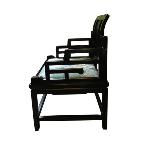 Black accent chair with lacquer finish with seat cushion.