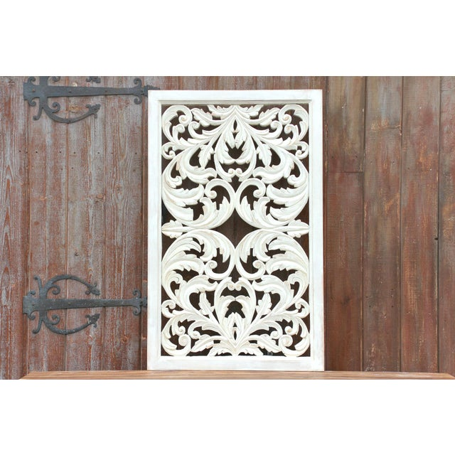 A beautiful whitewashed acanthus motif carved wood panel. Engaging in detail and visually striking, it's fitted for a wall...