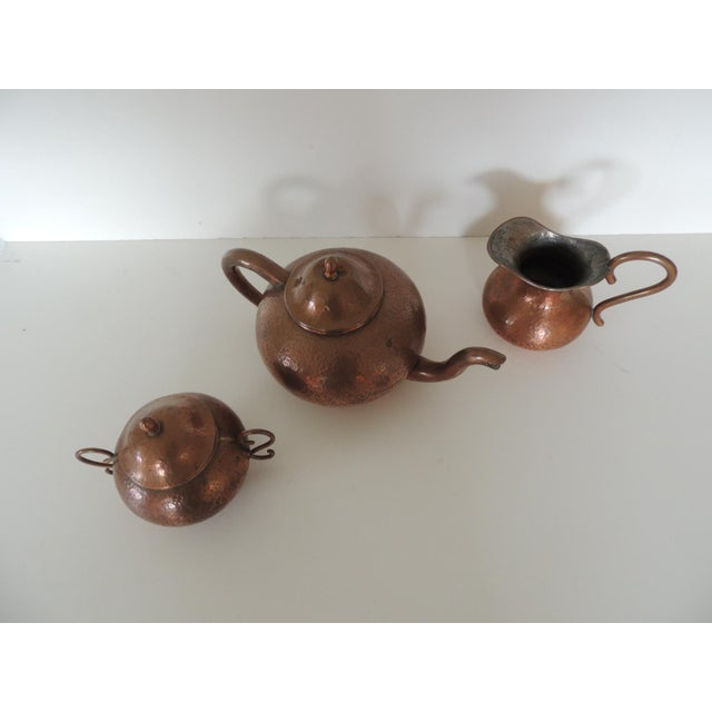 """Vintage copper tea or coffee serving set. Teapot Sugar and creamer serving pieces with handles. Measures: Teapot: 11""""W x..."""