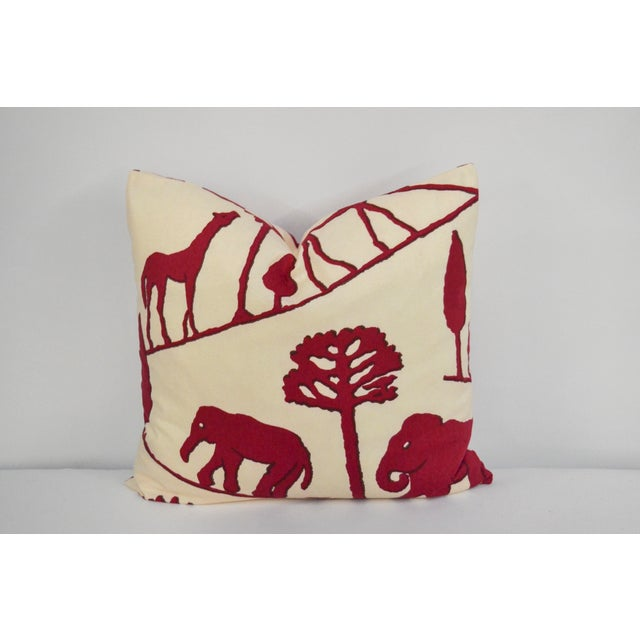 Decorative pillow covered in cotton Clarence House elephant print. Pillow has the same fabric on the front and back, with...