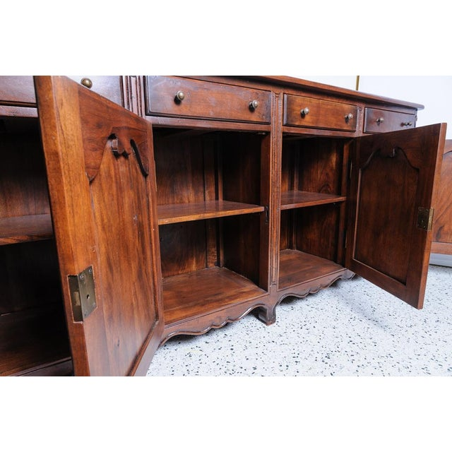 French, solid walnut buffet. Four drawers and four doors with one shelf below. Great quality and value.