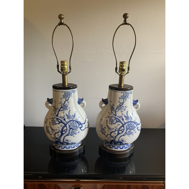 "Gorgeous pair of Frederick Cooper classic blue and white Chinese ""tang"" style porcelain lamps with walnut wood trim and..."