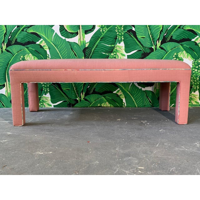 Upholstered bench or ottoman in true 80s style. Pink with pastel tropical piping. Excellent condition.