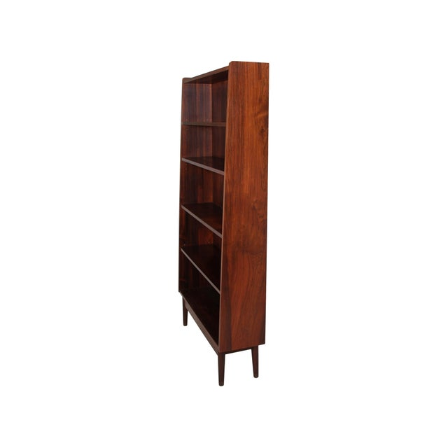 Stunning 1960's rose wood veneer bookcase made in Denmark. Excellent vintage condition overall. Some discoloration in the...
