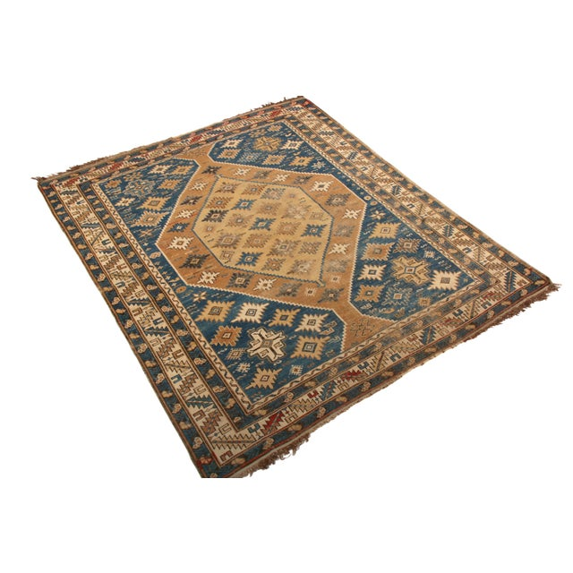Hand knotted in wool originating from Russia between 1910-1920, this antique Kuba rug enjoys a celebrated take on...