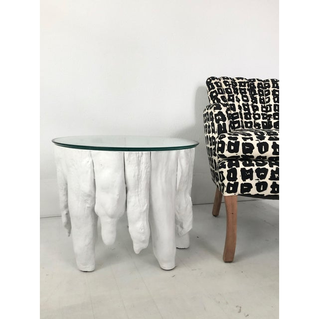 Brutalist cypress knee organic modern side table with a glass top. The glass top is beveled and the table is versatile as...