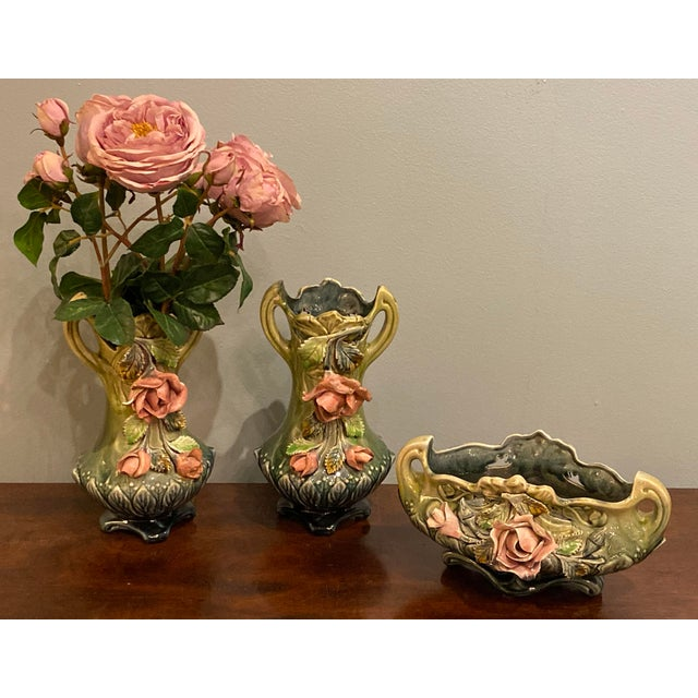 """Majolica three piece planter set with a majolica rose cache pot and a pair of vases. Vases 6"""" Wide x 4.25"""" Deep x 12"""" High..."""