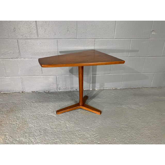 Unique side table with geometric, trapezoidal top manufactured by Dux of Sweden circa 1960's. This teak tri-leg table...