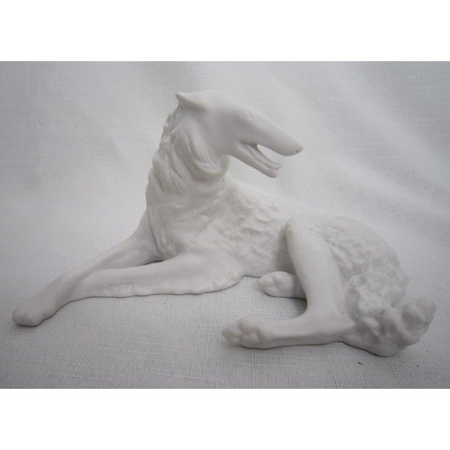 Charming English bisque figure of a Whippet/Greyhound. Maker's mark is stamped on the base.