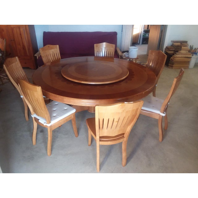 https://chairish-prod.freetls.fastly.net/image/product/sized/a417439a-a507-44d9-9f19-8236eda624fd/round-dining-table-with-lazy-susan-and-7-chairs-set-set-of-8-0967?aspect=fit&width=640&height=640