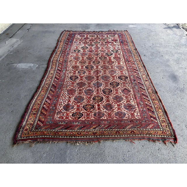"""Antique Persian Khamseh dimensions: 4'11""""x9' very low pile, vegetable dyed note: This early 1920s Khamseh has a beautiful..."""