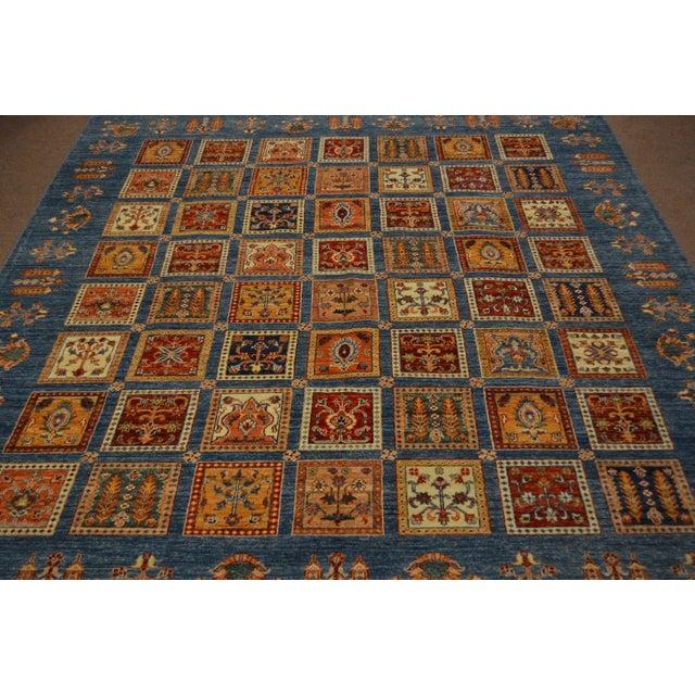This elegant hand knotted Persian Bakhtiari rug is made using natural dyes and handspun wool. This beautiful Kazak rug...