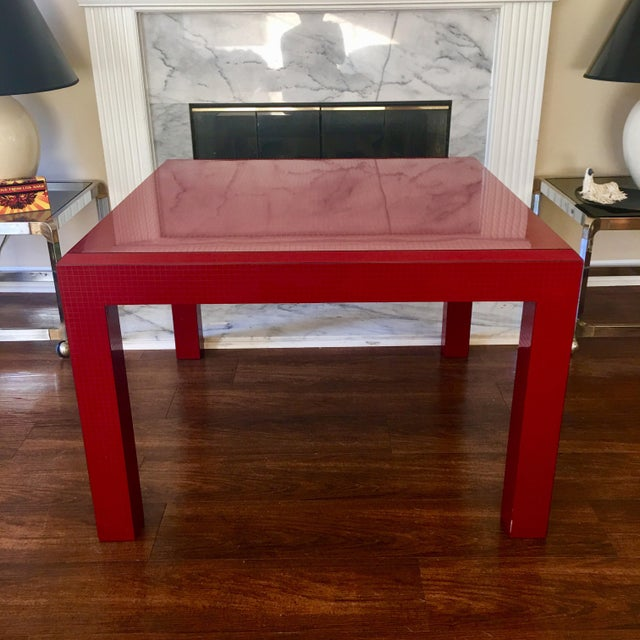 Fabulous and rare occasional table in high quality red laminate with s subtle graph paper or grid pattern. Beveled edge....