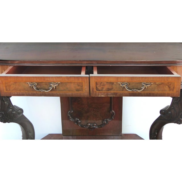 Offered for sale is a fine quality Italian made two-drawer console table with fine satinwood banding, splayed carved legs...