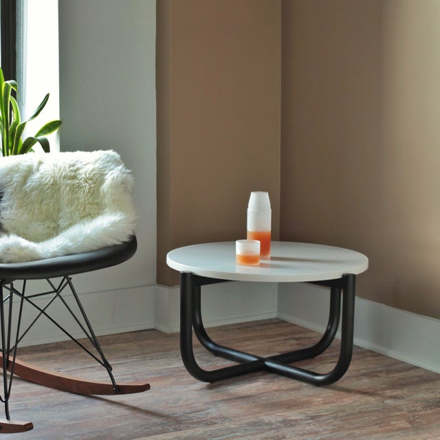Gathering Side Table is a minimal and highly functional design. Setting in the living room, it's good with the lounge...