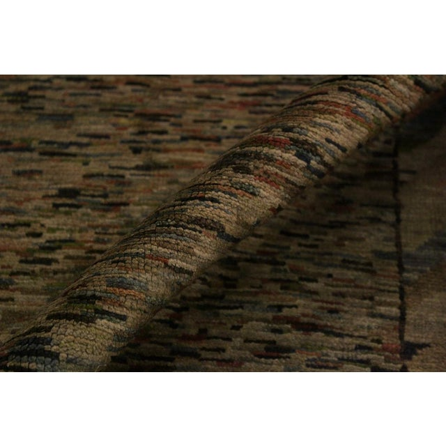 Masterfully hand-knotted by skilled artists, this over dyed hand knotted rug highlights careful attention to detail and...