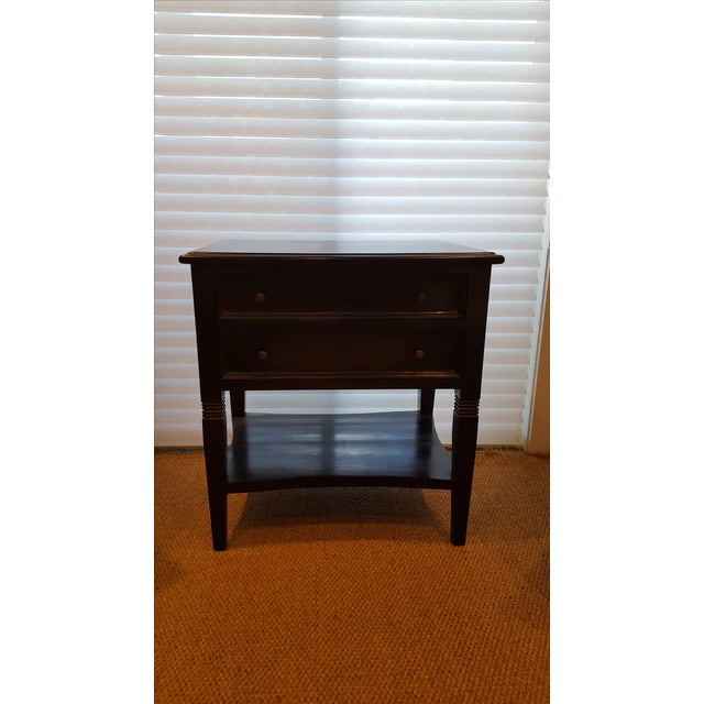 This handsome side table has a hand rubbed black finish and is crafted from mahogany. With its strong lines, this piece...