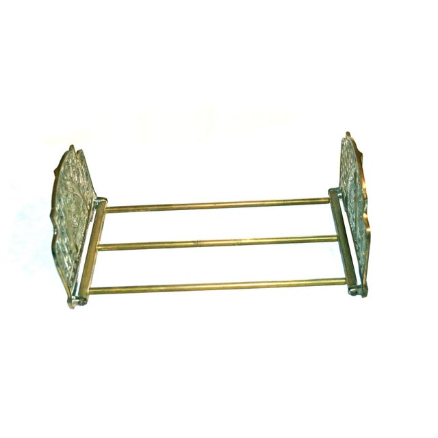 Scarce Art Nouveau folding and expandable book rack, 1920s, each end featuring an owl atop a book. Brass-plated cast iron....