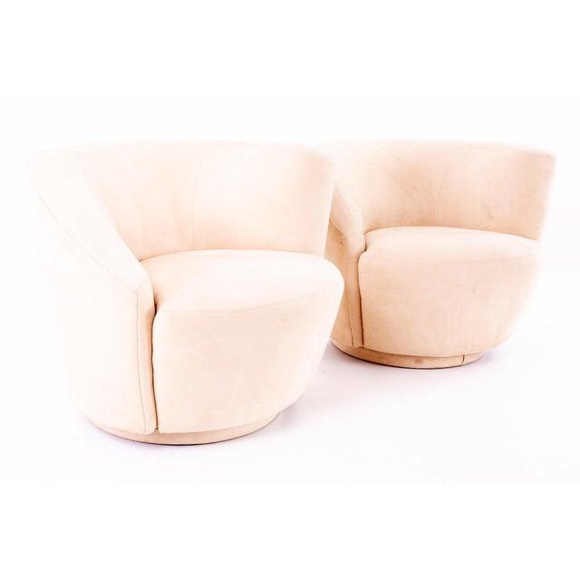 Vladimir Kagan Mid Century Nautilus Swivel Lounge Chairs - Pair Each chair measures 34.5 wide x 34 deep x 28.5 high with a...